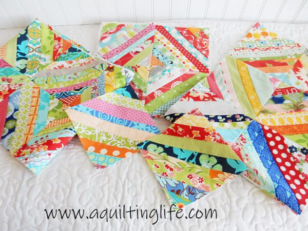 Scrap Quilt Ideas & Tips featured by top US quilting blog, A Quilting Life: image of Scrappy string blocks
