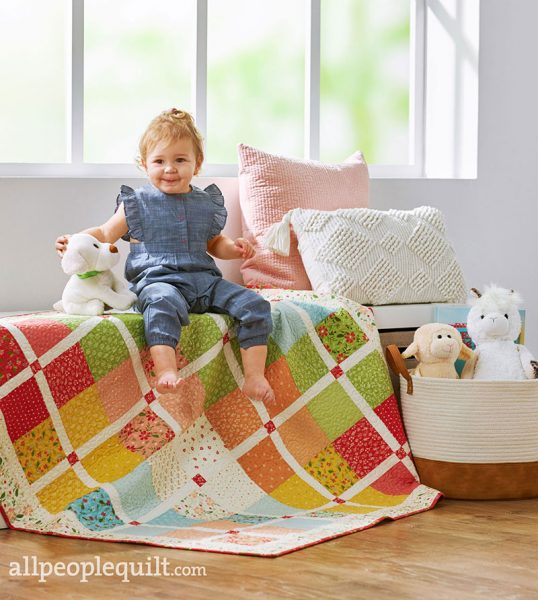 Charm Square Baby Quilt in Quilts & More featured by Top US Quilting Blog, A Quilting Life: image of charm square baby quilt