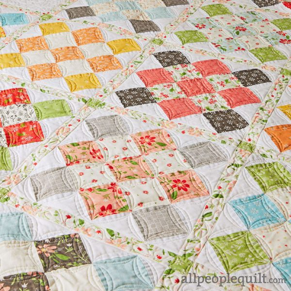 Granny Squared Quilt in Summer Sweet featured by Top US Quilting Blog A Quilting Life: image of Granny Squared Quilt