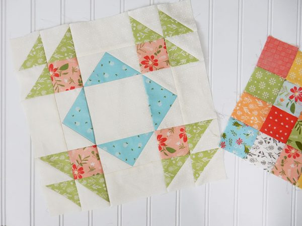A Quilting Life Block of the Month   January 2020 featured by Top US Quilting Blog, A Quilting Life: image of January block and scrappy patchwork