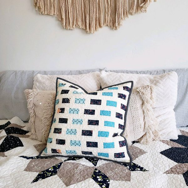 "Pillow Talk ""Pillow Fight"" featured by Top US Quilting Blog, A Quilting Life: image of scrappy pillow in blues"