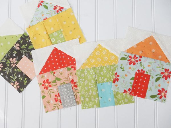 Works in Progress featured by Top US Quilting Blog, A Quilting Life: image of house quilt blocks
