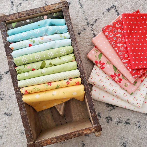 Saturday Seven 119 featured by Top US Quilting Blog, A Quilting Life: image of Summer Sweet fabrics in a box