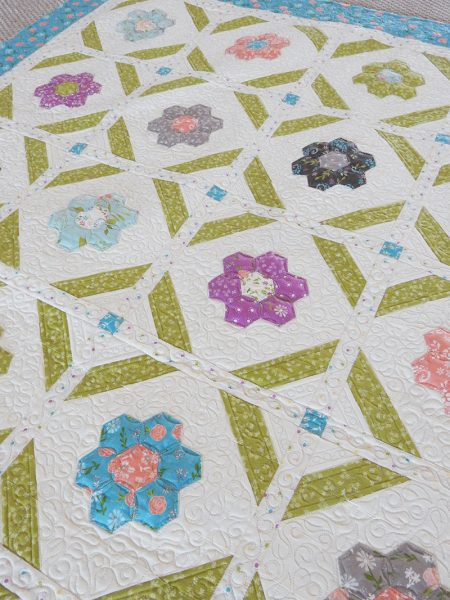 Blooms Grandmother's Flower Garden Quilt Pattern featured by Top US Quilting Blog, A quilting Life: image of Blooms quilt