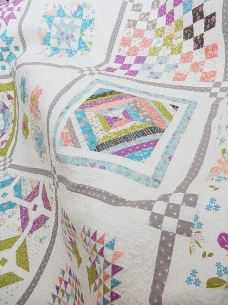 Labor of Love Sampler Quilt featured by Top US Quilting Blog, A Quilting Life: image of sampler quilt