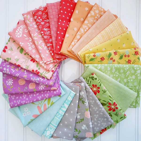 Saturday Seven 124 featured by Top US Quilting Blog, A Quilting Life: image of scrappy fabrics