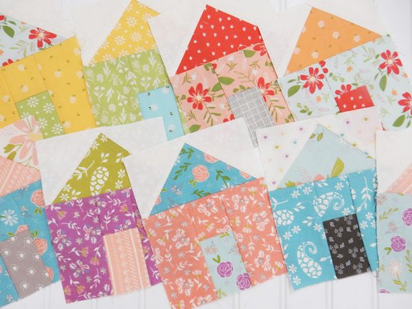 Best Tips for Works in Progress featured by Top US Quilting Blog, A Quilting Life: image of house quilt blocks