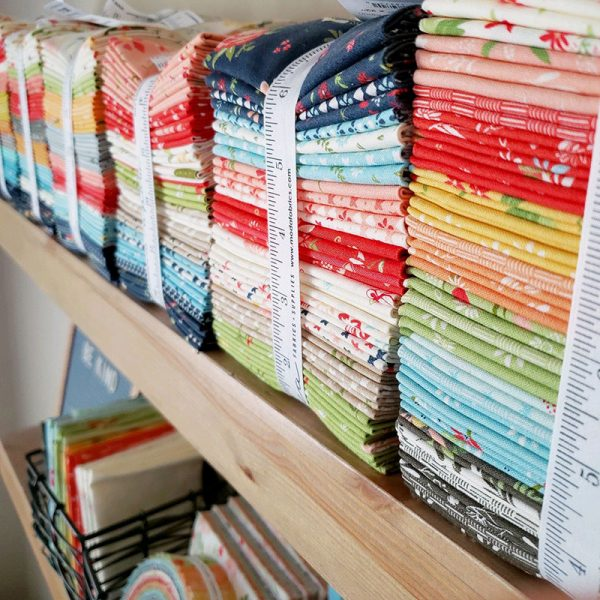 11 Productivity Tips for Quilters featured by Top US Quilting Blog, A Quilting Life: image of fabric bundles