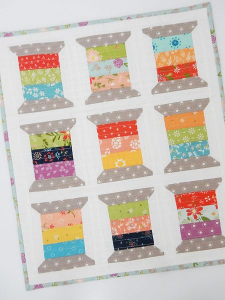 Saturday Seven 127 featured by Top US Quilting Blog, A Quilting Life: image of mini spools quilt