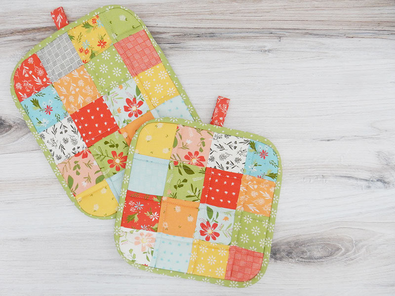 How to Make a Quilted Potholder featured by Top US Quilting Blog, A Quilting Life: Image of quilted potholders