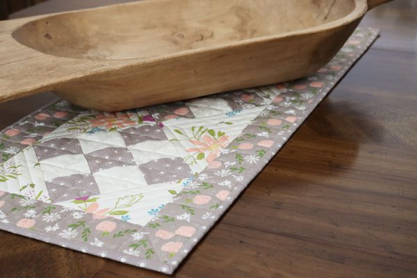 9-Patch Table Runner Tutorial featured by Top US Quilting Blog, A Quilting Life: image of scrappy 9-patch table runner